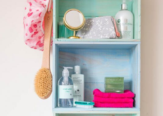 Upcycled bathroom crate shelves featuring Rust-Oleum Colour Wash Paint